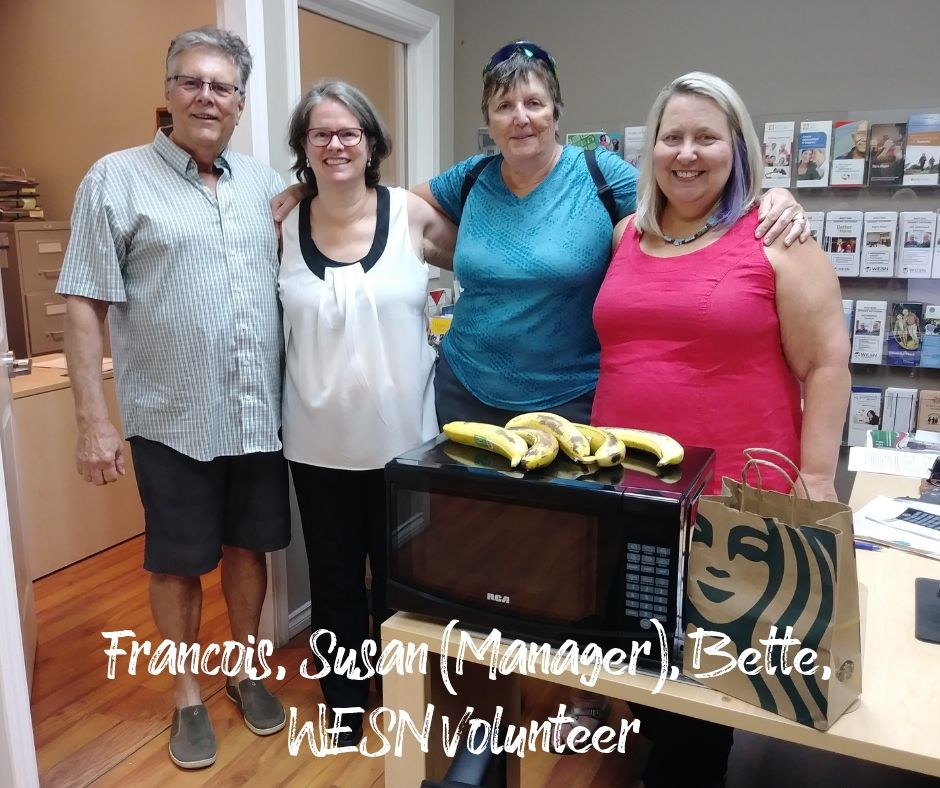WESN Centre - Francois Daoust, Susan (Manager), Bette Daoust, and volunteer with new microwave oven and Starbucks donations!